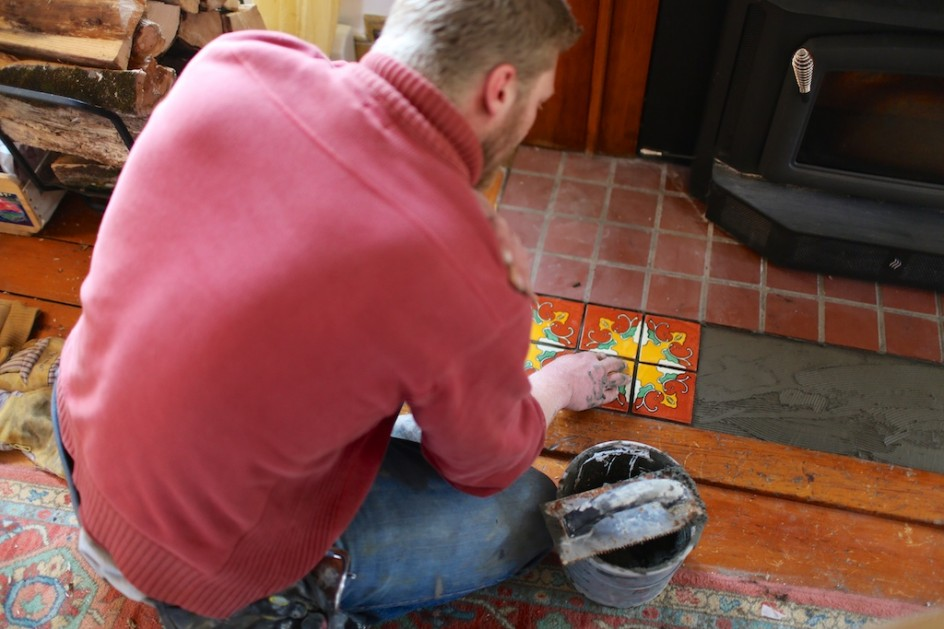 Ben laying tiles